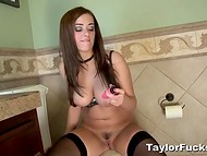 Exceptional Taylor Vixen in black stockings sat down on the toilet bowl to quench sexual arousal 11