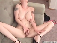 Short-haired blonde in high heels skillfully stimulating her hairy pussy 11