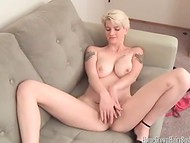 Short-haired blonde in high heels skillfully stimulating her hairy pussy