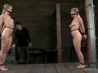 Perverted fellow spanked with paddle two slender chained cuties in turn