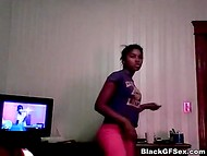 Ebony sexpot dancing, singing, and showing her shaved twat in the homemade video