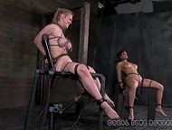 Two big-boobied slaves were tied to the sex-machines and punished with low-voltage