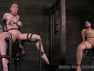 Two big-boobied slaves were tied to the sex-machines and punished with low-voltage 9