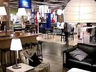 Brunette sexpot from Spain flashes her enormous breasts in the furniture store 7