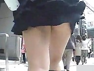 Smart fan of upskirt videos could not stop following seductive young lady in short skirt 4