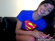 Irresistible Latina in Superman t-shirt caresses her pussy in front of the webcam 8