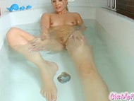 Teenage whore bathing her juicy charms being tired of masturbation with a toy 8