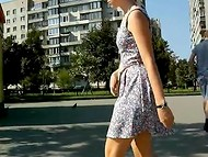 Russian girls in short dresses and skirts demonstrate their slender legs walking around the city 10