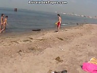 Slim Russian teen is intimate with her boyfriend in front of the camera on the beach 4