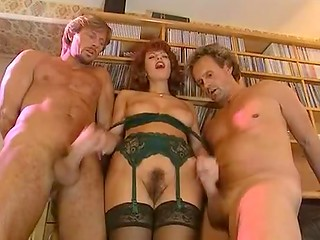 Classic porn video starring Hungarian redhead Simona Valli getting double penetrated