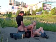 Blonde in stockings pleases two dudes' penises in the street in broad daylight
