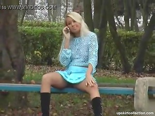 Seductive blonde chick does not even notice that somebody is filming her while she is talking on the phone