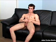 Tired after workday at the office, guy returned home and relaxed jerking off on the sofa