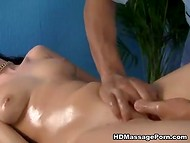 Black-skinned masseur oiled slender client's shaved pussy before his special treatments 6