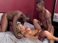 Two black machos fucked curvy European hottie from both ends in the threesome porn clip