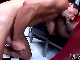 Dark-skinned shemale in red dress uses her penis to turn new friend crazy