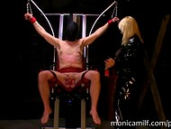 Norwegian female dominantrix Monica Milf whips erected dick of her chained prisoner