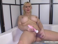 Norwegian Monica Milf stimulates her vagina in the warm bathtub with everything that comes to hands