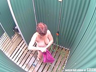 Mature woman with big saggy tits was caught on hidden camera in the cabin near the public pool