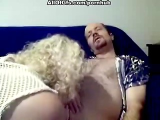 MILF blonde with curly hair gets cock in mouth