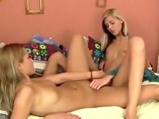 Teen Serbian beauties sweetly kiss and gently stimulate their shaved peaches