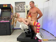 Husky dude invites on his massive cock cute girl in roller-skates in the game room