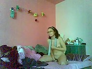 Inexperienced Romanian girl with glasses teased her sissy in the bedroom in front of the webcam 10