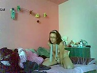 Inexperienced Romanian girl with glasses teased her sissy in the bedroom in front of the webcam 7