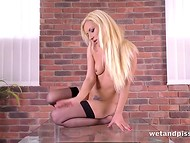 Blonde in black stockings works her anus out and quenches thirst with own urine 4