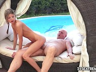 Petite Gina Gerson appeases bald old man with her tight pussy on the soft bed by the poolside