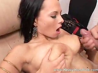 Brunette with big natural boobs gets cumshotted