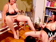 Females in black outfits demonstrating some ways of satisfying pussies in the lesbian scene 8