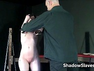 Obedient brunette girl was caught by two perverted men, who spanked tender body with whips 6
