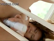 Sex toy helps Japanese Nozomi Tsukamoto in white chemise to satisfy herself on the stairs 7