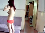 Asian girl in red panties, who recently woke up, takes a cup of tea and didn't know about the hidden camera 10