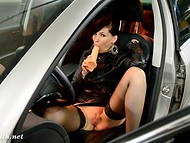 American porn actress Jeny Smith playing dirty with rubber dildo in her car at closed parking