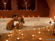Lovers moved to the romantic bedroom after sweet kissing in the warm tub