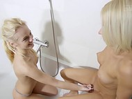 Light-haired lesbians took off sexy lingerie, took dual-ended dildo, and had fun in the bath 4