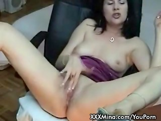 Nasty brunette MILF smoking and stroking her pussy on cam