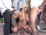 Blonde fellatrix blows black fellows' ramrods and gets face covered in sticky jizz