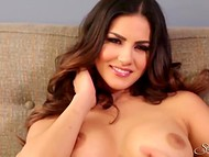 Magnificent Sunny Leone flashed her gorgeous tits and rubbed peanut in front of camera 11