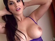 Tempting lady Sunny Leone with delicious body released tits and pussy from sexy clothes to masturbate