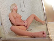 Attractive Jessica B with long legs tenderly kneads smooth peach in the shower 10