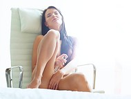 Lonely beauty brushed hair and started to stimulate vagina with dildo in the armchair 11
