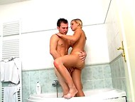 Buddy actively penetrates his young babe in variable sex positions in the bathroom 5