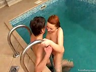 Red-haired Russian girl with long legs rides partner's wiener in the small pool 7