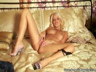 Beddable golden-haired diva from Czech Republic Jana Cova gently rubs peach