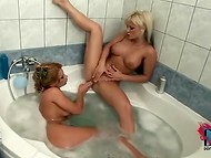 Taking bath together didn't go without licking each other's pussy for two horny females