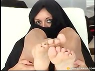 Curious Arab girl shrouded from head to foot in a black veil caresses penis with feet and mouth 4