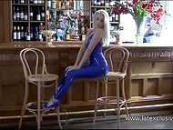 Slender blonde, who poses by bar counter, looks stunning in latex costume 5